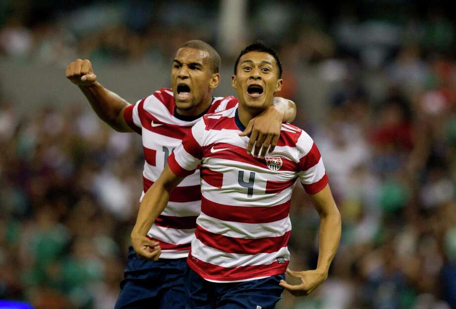 U.S Michael Orozco, right, celebrates with teammate Terrence Boyd after scoring after scoring during a friendly soccer game against Mexico in Mexico City, Wednesday, Aug. 15, 2012. (AP Photo/Eduardo Verdugo) Photo: Eduardo Verdugo, Associated Press / AP