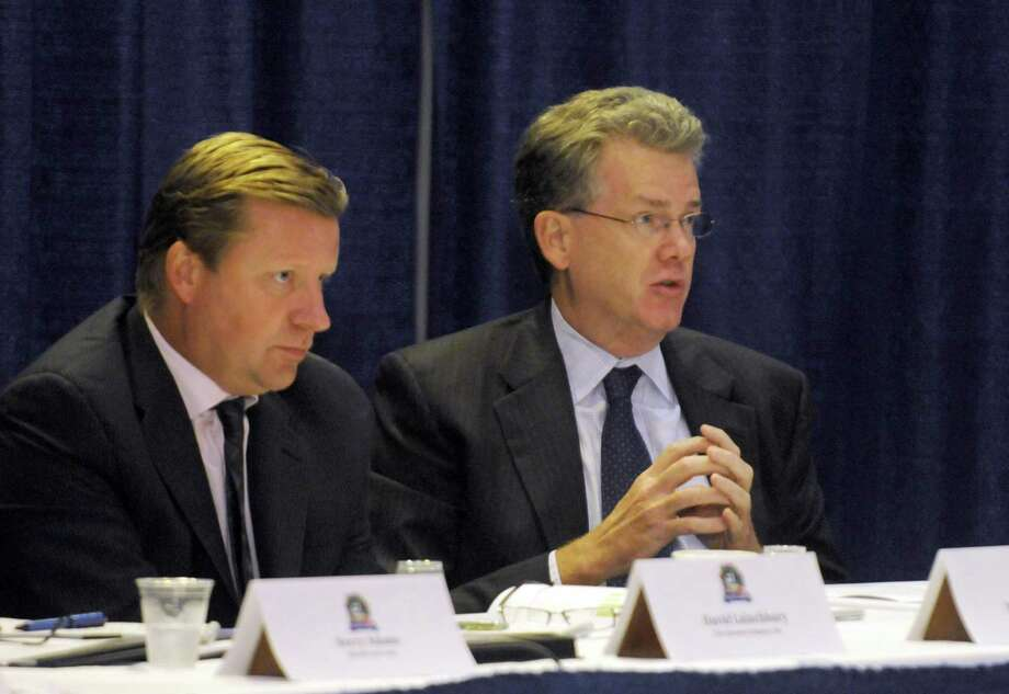 David Lainchbury of The Dannon Company, left, and James McConeghy of Chobani speak during the Governor Andrew M. Cuomo New York State Togurt Summit in Albany, NY Wednesday Aug. 15, 2012. (Michael P. Farrell/Times Union) Photo: Michael P. Farrell