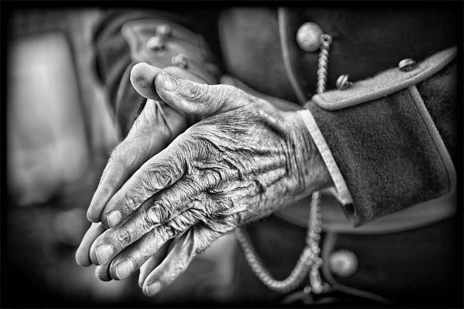 Close up of the hands of a civil war re-enactor taken in September 2011 at Saratoga's Congress Park. 3rd place winner in the Monochrome category of the January 2012 monthly print competition for the Schenectady Photographic Society. (Doug Mitchell)