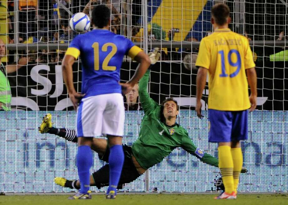 Brazil's Alexandre Pato, not in picture, scores final result, 0-3, on a penalty kick against Sweden's goalie Andreas Isaksson. Photo: FREDRIK SANDBERG / SCANPIX, Associated Press / SCANPIX SWEDEN