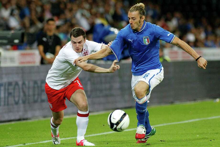 England's Adam Johnson, left, fights for the ball with Italy's Federico Balzaretti, right, during an international friendly test match between the national soccer teams of Italy and England at the Stade de Suisse stadium, in Bern, Switzerland, Wednesday, Aug. 15, 2012. (AP Photo/Keystone, Salvatore Di Nolfi) Photo: SALVATORE DI NOLFI, Associated Press / KEYSTONE