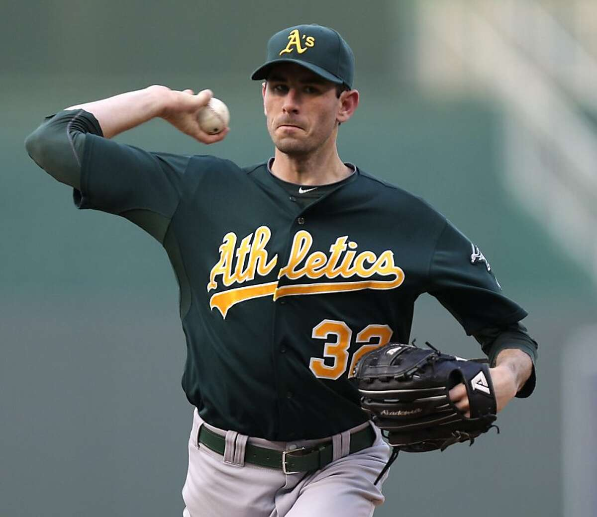 KANSAS CITY, MO - AUGUST 15: Brandon McCarthy #32 of the Oakland Athletics warms up during a game against the Kansas City Royals in the first inning on August 15, 2012 at Kauffman Stadium in Kansas City, Missouri. (Photo by Ed Zurga/Getty Images)