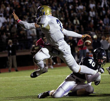 Tivy quarterback Johnny Manziel escapes a tackle to score a touchdown in the ifrst half as Boerne Champion plays Kerrville Tivy at Greyhound Stadium in Boerne on Oct. 29, 2010. Photo: Tom Reel, San Antonio Express-News / © 2010 San Antonio Express-News