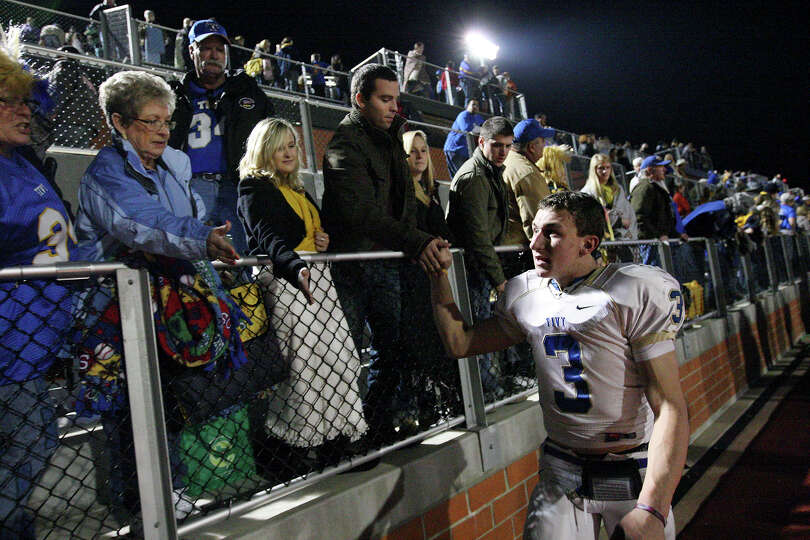 Kerrville Tivy's Johnny Manziel high-fives fans after the game with Lake Travis Friday Nov. 19, 2