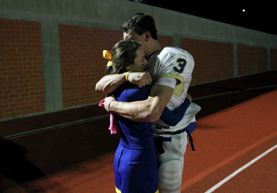 Kerrville Tivy's Johnny Manziel hugs his sister Meri Manziel after the game with Lake Travis Friday Nov. 19, 2010 at Heroes Stadium. Lake Travis won 48-42. Photo: Edward A. Ornelas, San Antonio Express-News / eaornelas@express-news.net