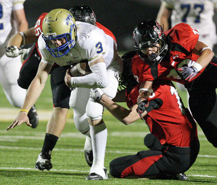 Kerrville Tivy's Johnny Manziel is tackled by Lake Travis defenders during first half action Frid