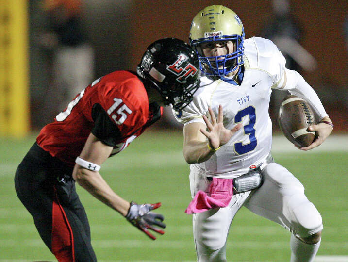 Kerrville Tivy's Johnny Manziel looks for room around Lake Travis' Bryan Kribbs during first half