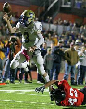 Kerrville Tivy's Johnny Manziel pass to teammate Kerrville Tivy's Braedon White (not pictured) to score on a 2-point conversion around Lake Travis' Corbin Crow during first half action Friday Nov. 19, 2010 at Heroes Stadium. Photo: Edward A. Ornelas, San Antonio Express-News / eaornelas@express-news.net