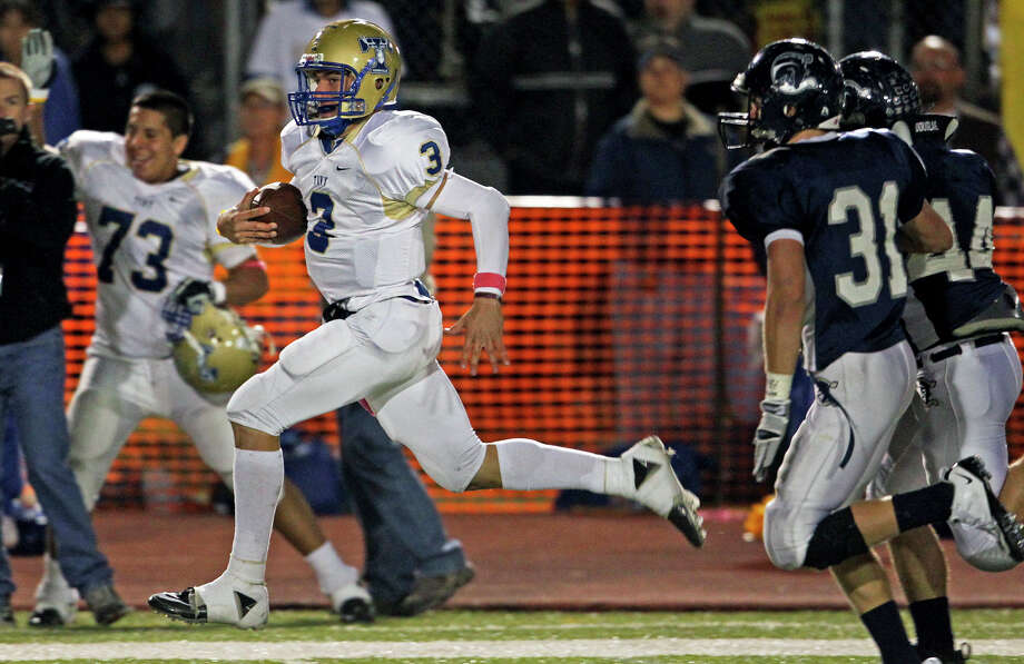 Johnny Manziel circles right for a touchdown after nearly being tackled in the middle. Boerne Champion plays Kerrville Tivy at Greyhound Stadium in Boerne on Oct. 29, 2010. Photo: Tom Reel, San Antonio Express-News / © 2010 San Antonio Express-News