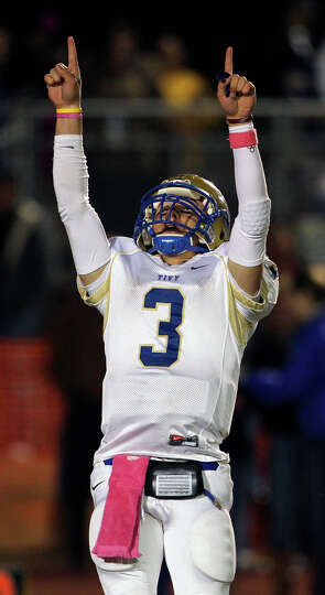 Johnny Manziel signals skyward after a touchdown. Boerne Champion plays Kerrville Tivy at Greyhou