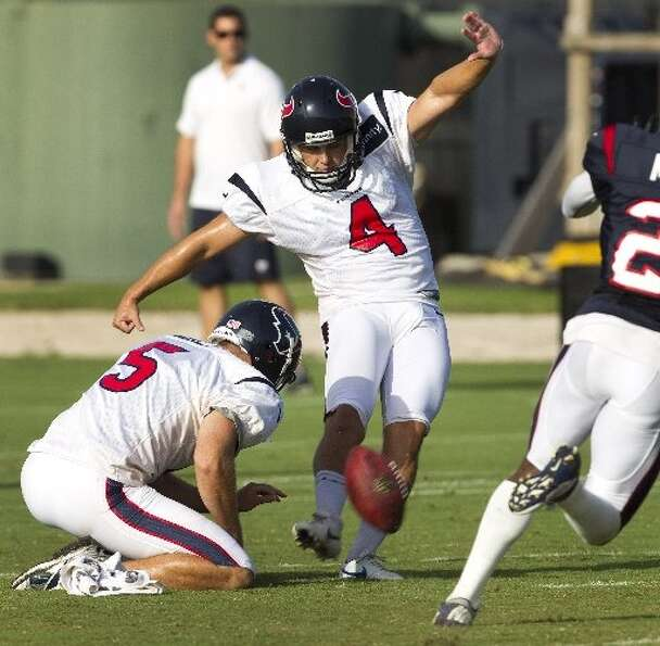 Randy Bullock connects with a big kick at camp. (Brett Coomer / Houston Chronicle)