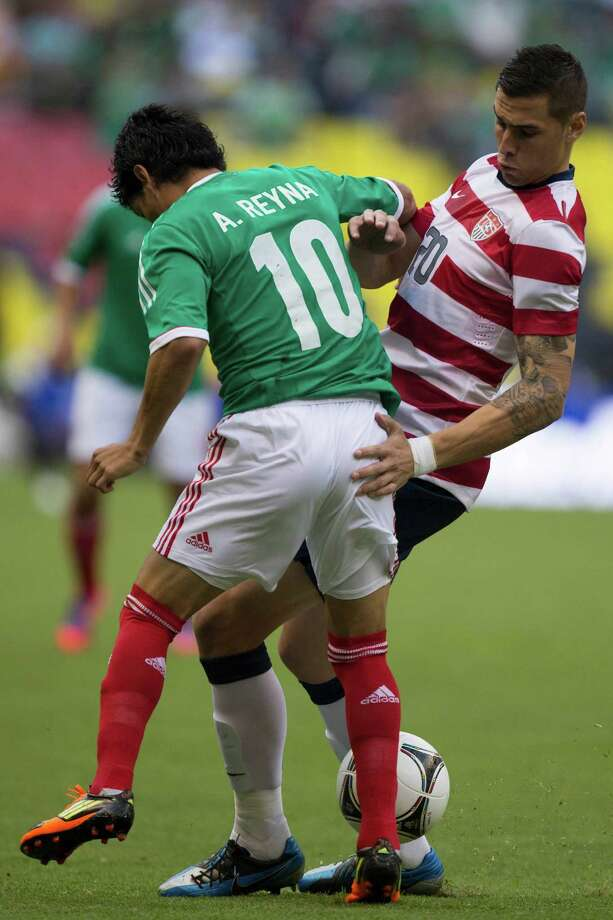 MEXICO CITY, MEXICO - AUGUST 15: Angel Reina of Mexico fights for the ball with Geoff Cameron of the United States during a FIFA friendly match between Mexico and US at Azteca Stadium on August 15, 2012 in Mexico City, Mexico. Photo: Miguel Tovar, Getty Images / 2012 Getty Images