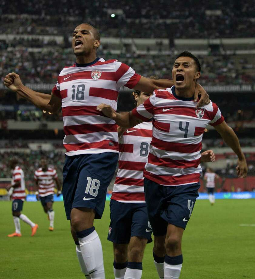 MEXICO CITY, MEXICO - AUGUST 15:  Michael Orozco of the United States celebrates after scoring with teammates during a FIFA friendly match between Mexico and US at Azteca Stadium on August 15, 2012 in Mexico City, Mexico. Photo: Miguel Tovar, Getty Images / 2012 Getty Images
