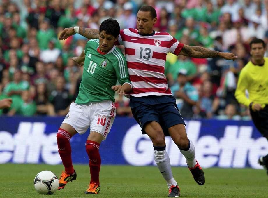 Mexico's Angel Reyna, left, and U.S. Jermaine Jones battle for the ball during a friendly soccer match in Mexico City, Wednesday, Aug. 15, 2012. (AP Photo/Eduardo Verdugo) Photo: Eduardo Verdugo, Associated Press / AP