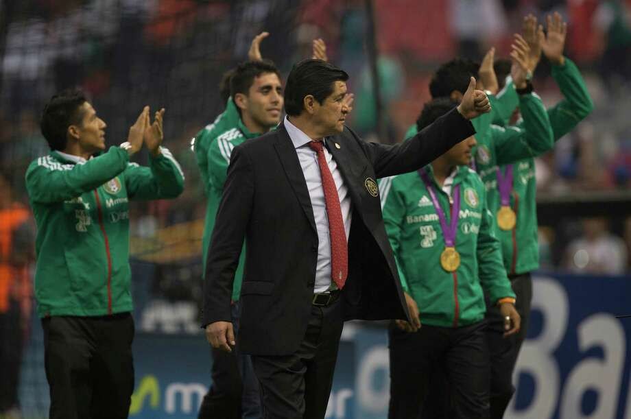 MEXICO CITY, MEXICO - AUGUST 15:  Players of Mexico sub 23 national soccer team cheer with theirs gold medals during a FIFA friendly match between Mexico and US at Azteca Stadium on August 15, 2012 in Mexico City, Mexico. Photo: Miguel Tovar, Getty Images / 2012 Getty Images