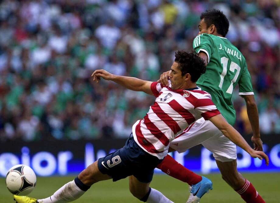 Mexico's Jesus Zabala, back, fights for the ball with U.S. Herculez Gomez during a friendly soccer match in Mexico City, Wednesday, Aug. 15, 2012. (AP Photo/Christian Palma) Photo: Christian Palma, Associated Press / AP
