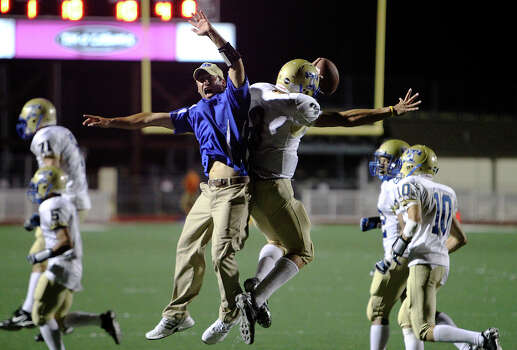 Kerrville Tivy's Johnny Manziel (03) celebrates with assistant coach Shane Jones after the Antlers defeated Madison, 39-34, in football at Comalander Stadium on Friday, Sept. 3, 2010. Photo: Kin Man Hui, San Antonio Express-News / San Antonio Express-News