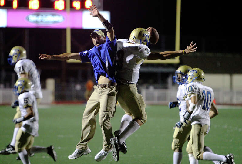 Kerrville Tivy's Johnny Manziel (03) celebrates with assistant coach Shane Jones after the Antler