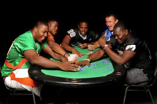 Defensive tackle Quincy Russell of Sam Houston, left, running back Aaron Green of Madison, running back Malcolm Brown of Steele, quarterback Johnny Manziel of Kerrville Tivy and defensive tackle Marquis Anderson of Steele battle for the Blue Chips at Pedrotti's North Wind Ranch in Helotes. Photo: Billy Calzada, San Antonio Express-News / gcalzada@express-news.net