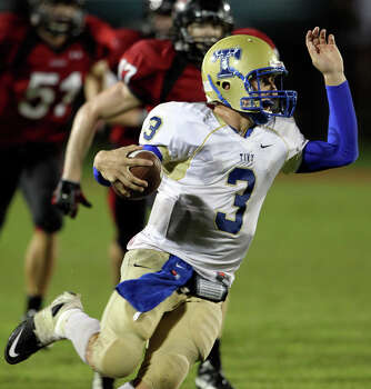 Tivy quarterback Johnny Manziel makes a quick turn against the pursuit as Lake Travis hosts Kerville Tivy at Lake Travis Stadium on September 17, 2010. Photo: Tom Reel, San Antonio Express-News / © 2010 San Antonio Express-News