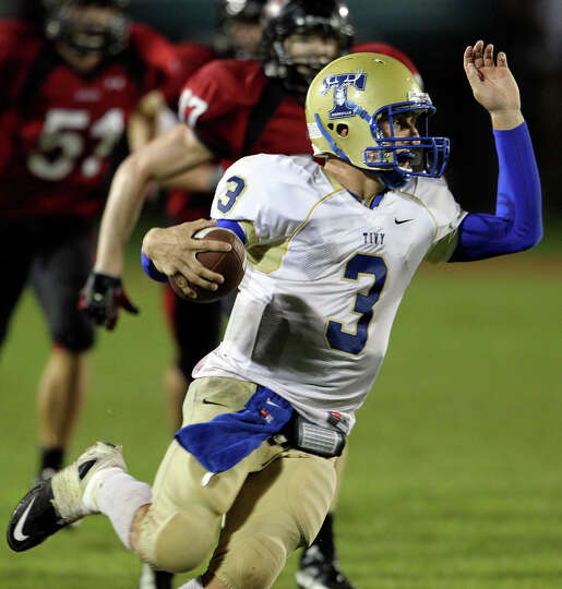 Tivy quarterback Johnny Manziel makes a quick turn against the pursuit as Lake Travis hosts Kervi