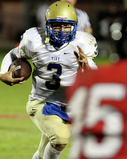 Johnny Manziel rolls for the Antlers as Lake Travis hosts Kerville Tivy at Lake Travis Stadium on