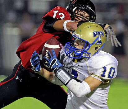 Kason Fornes struggles trying to get control of a pass from the Antler's Johnny Manziel as Zach Strueling moves in to break up the play as Lake Travis hosts Kerville Tivy at Lake Travis Stadium on September 17, 2010. Photo: Tom Reel, San Antonio Express-News / © 2010 San Antonio Express-News