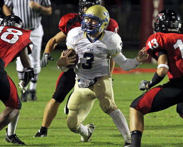 Tivy quarterback Johnny Manziel finds himself in a trap of Cavalier defenders as Lake Travis hosts Kerville Tivy at Lake Travis Stadium on September 17, 2010. Photo: Tom Reel, San Antonio Express-News / © 2010 San Antonio Express-News