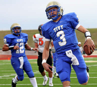 Antlers quarterback Johnny Manziel rolls into the end zone for a touchdown in the first half as Kerrville Tivy plays Medina Valley in playoff action at Heroes Stadium on Nov. 27, 2009. Photo: Tom Reel, San Antonio Express-News / treel@express-news.net