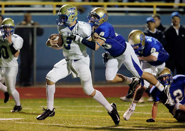 Kerrville-Tivy's Johnny Manziel (03) gets Alamo Heights' Philip Massari (43) off his feet at Orem Stadium on Friday, October 30, 2009. Photo: Kin Man Hui, San Antonio Express-News / kmhui@express-news.net