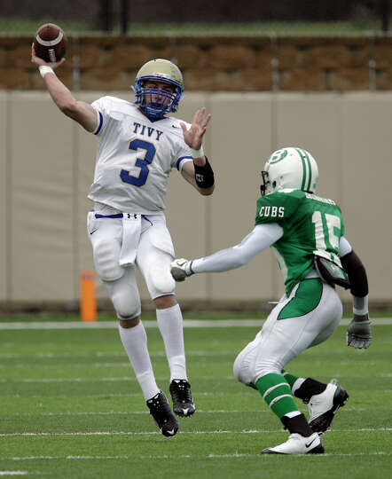 Kerrville-Tivy's Johnny Manziel (03) attempts a pass against Brenham's Michael Walker (15) in the