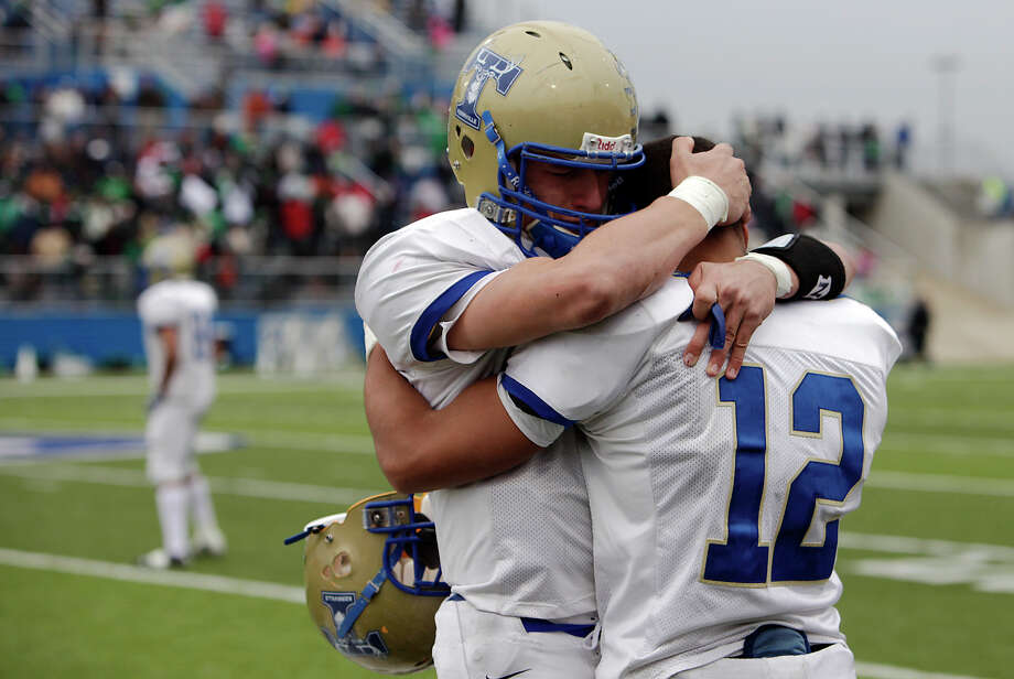 Kerrville-Tivy's Johnny Manziel (left) consoles teammate Braedon White as Brenham defeated the Antlers in the 4A football state semifinals in Georgetown, Texas on Saturday, Dec. 12, 2009. Tivy lost 31-21. Photo: Kin Man Hui, San Antonio Express-News / San Antonio Express-News