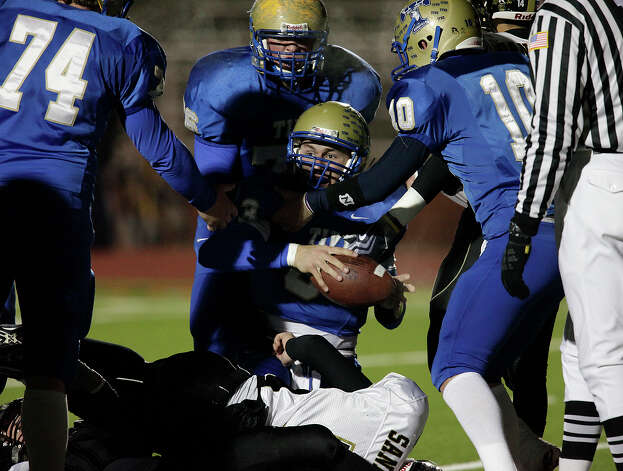 Kerrville-Tivy's Johnny Manziel (center) gets picked up by teammates after he scored a one-yard touchdown against Calhoun in Class 4A Div. II state quarterfinal football game at Heroes Stadium on Friday, Dec. 4, 2009. Photo: Kin Man Hui, San Antonio Express-News / San Antonio Express-News
