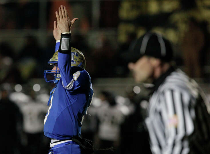 Kerrville-Tivy Johnny Manziel (left) signals his own touchdown against Calhoun in Class 4A Div. I