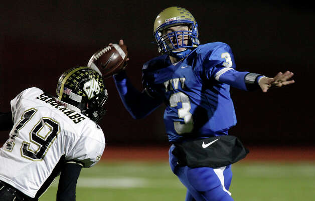 Kerrville-Tivy's Johnny Manziel (03) attempts a pass on the run against Calhoun's Nick McCrory (19) during their Class 4A Div. II state quarterfinal game at Heroes Stadium on Friday, Dec. 4, 2009. Photo: Kin Man Hui, San Antonio Express-News / kmhui@express-news.net