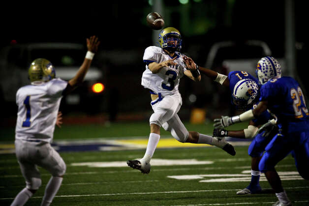Tivy quarterback Johnny Manziel throws on the run in the first half Friday, November 7, 2008 at SCUCISD Stadium. Manziel took over at quarterback after starter Colton Palmer threw two interceptions. Photo: Express-News File Photo / SAN ANTONIO EXPRESS NEWS