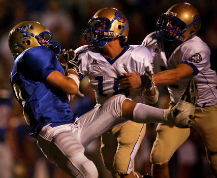 Tivy receiver Johnny Manziel makes a long reception after getting past Heights defenders Mitchell Dan (18) and Colin Bibb (7) in the first half Friday, October 31, 2008 at Tivy Stadium. Photo: Express-News File Photo / SAN ANTONIO EXPRESS NEWS