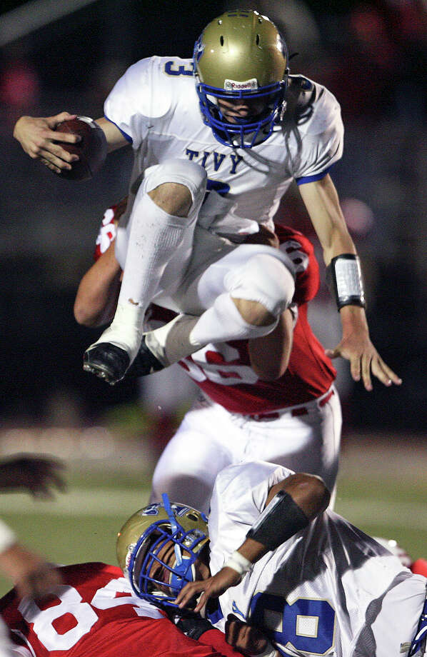 Tivy's Johnny Manziel goes over Canyon tacklers. New Braunfels Canyon plays Kerrville Tivy at Canyon Friday, October 17, 2008. Photo: Tom Reel, San Antonio Express-News / treel@express-news.net