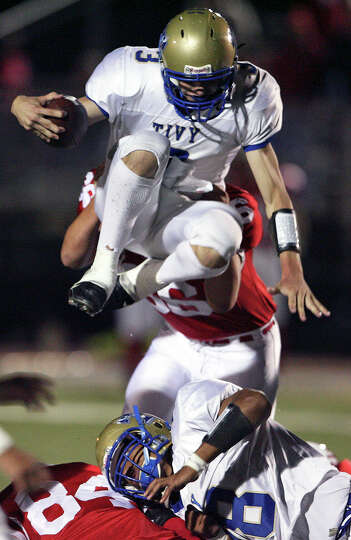 Tivy's Johnny Manziel goes over Canyon tacklers. New Braunfels Canyon plays Kerrville Tivy at Can