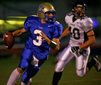 Tivy quarterback Johnny Manziel heads upfield on a run in the first half Friday, September 26, 2008 at Tivy Stadium. Photo: Express-News File Photo / SAN ANTONIO EXPRESS NEWS