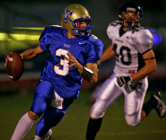 Tivy quarterback Johnny Manziel heads upfield on a run in the first half Friday, September 26, 20