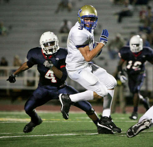 Tivy receiver Johnny Manziel spins out of a the way of Roosevelt's Crosby Adams in the first half Friday, August 29, 2008 at Comalander Stadium. Photo: Express-News File Photo / SAN ANTONIO EXPRESS NEWS