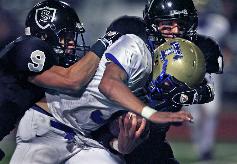 Knight defenders Shane Huhn (9) and Jake Hatcher put the brakes on a run by Antler quarterback Jo