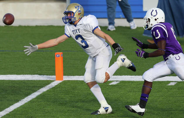 Kerrville Tivy's Johnny Manziel misses a pass as he is defended by Dayton's Cameron Lacour during second half action of the Class 4A Division II state seminfinal Saturday Dec. 13, 2008 at Georgetown High School stadium in Georgetown, Tx. Dayton won 31-28. Photo: Edward A. Ornelas, San Antonio Express-News / eornelas@express-news.net