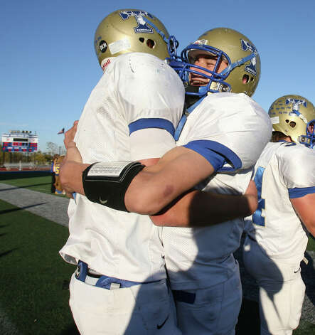 Kerrville Tivy's Johnny Manziel and Colton Palmer hug each other after defeating Pflugerville Hendrickson 45-14 at Bob Shelton Stadium in Buda, Texasin the Class 4A Sate Quarterfinals Saturday Dec.6, 2008. Photo: Express-News File Photo / delopez@express-news.net