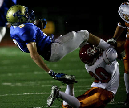 Tivy's Johnny Manziel is brought down after making a catch by Trever Garcia in the first half Friday, November 28, 2008 at Comalander Stadium. Photo: Express-News File Photo / SAN ANTONIO EXPRESS NEWS