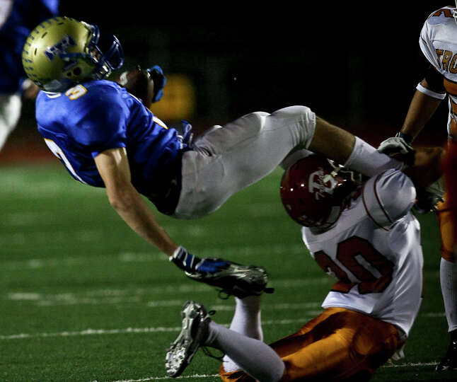 Tivy's Johnny Manziel is brought down after making a catch by Trever Garcia in the first half Fri