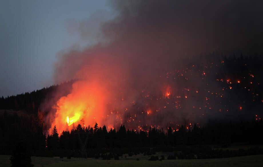 The Taylor Bridge Fire burns a hillside near the intersection of Highway 970 and 97 near Cle Elum on Wednesday, August 15, 2012. The Taylor Bridge Fire has forced hundreds to evacuate and has burned dozens of homes. Photo: JOSHUA TRUJILLO / SEATTLEPI.COM