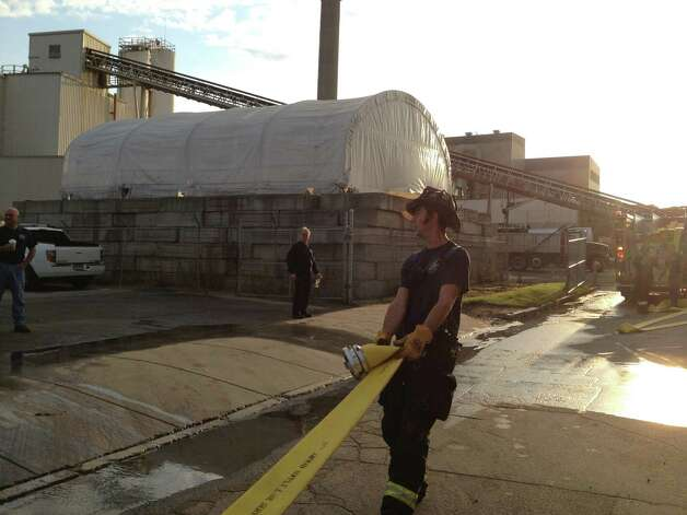 Bridgeport firefighters respond to a fire at the O&G construction plant in Bridgeport, Conn. the morning of Thursday, Aug. 16, 2012. Photo: Frank Juliano