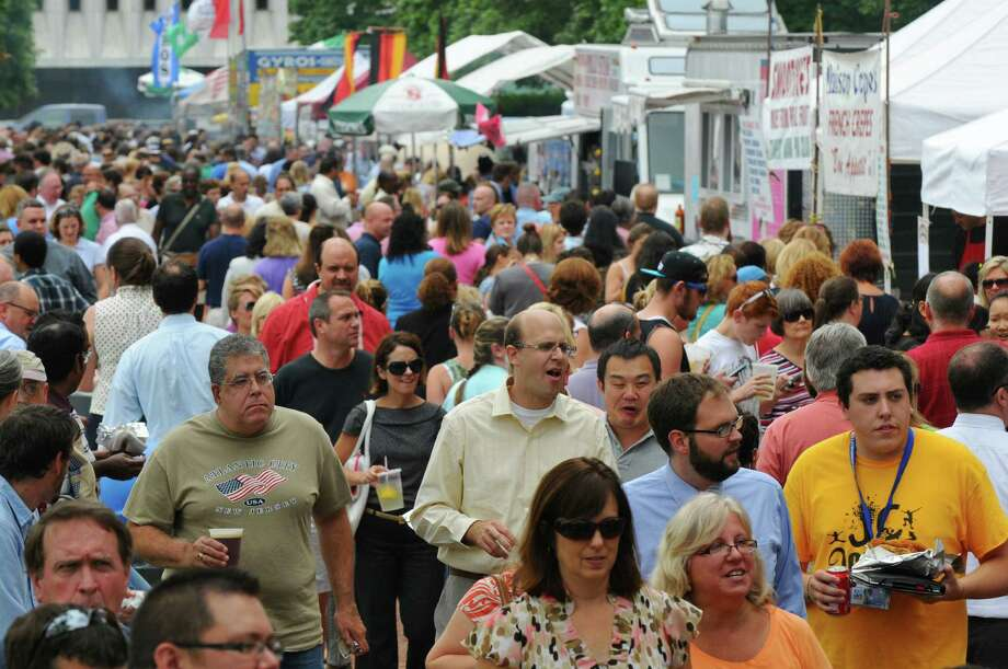 Crowds walk past food booths during the Empire State Plaza Food Festival on Wednesday Aug. 15, 2012 in Albany, NY.  (Philip Kamrass / Times Union) Photo: Philip Kamrass / 00018757A